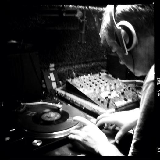 Deano von Lounge aka DJ Butcher tries to stop his vinyl melting in the 47 degree heat.
